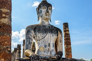 Buddha statue among the ruins