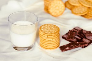A glass of milk and cookies for a diet