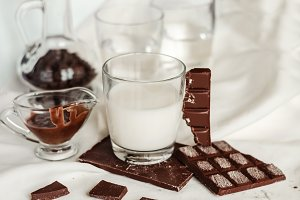A glass of milk and tiles of milk chocolate
