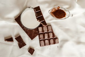 Pieces of chocolate and a glass of milk
