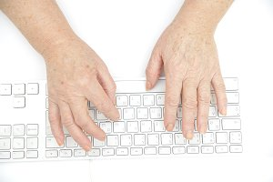 Hands of an old female typing