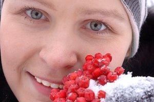 Girl holding mountain ash berries
