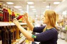 Young woman in the supermarket readi