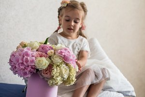 little girl with a big bouquet of fresh flowers