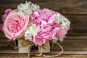 beautiful flowers on wooden background, various , place for text, closeup