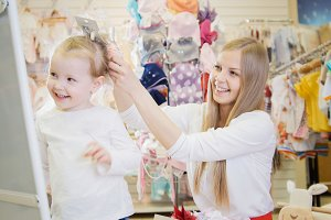 Mother and daughter choose a accessorise
