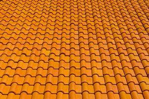 orange tiles roof for background.