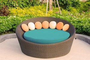 Rattan armchair furniture in garden.