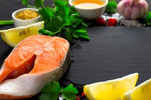 Fresh raw salmon steak And ingredients for preparation. Selectiv