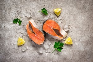 Fresh salmon fish. Raw salmon steaks on ice. Food background. To