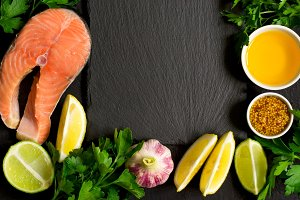Fresh raw salmon steak And ingredients for preparation around th