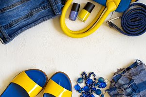 flat lay Female clothing and accessories in bright yellow blue s