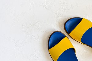 Female youth bright Yellow blue varnished summer sandals on a wh
