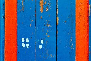 Blue and red wooden board lumber.