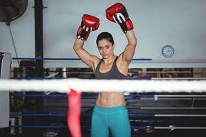 Excited female boxer posing after victory
