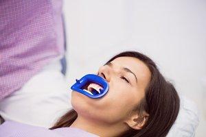Patient receiving a dental treatment