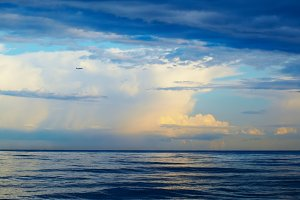 Plane, sea, thunderstorm