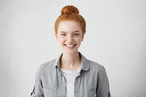 Portrait of positive cheerful teenage girl feeling happy, smiling broadly at camera after boy she likes returned her love and asked her out on date. Human facial expressions, emotions and feelings