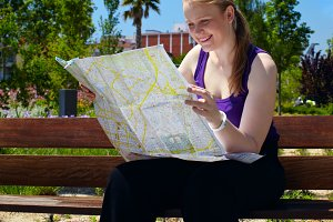 Girl is reading the map.