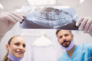 Dentists discussing over an x-ray