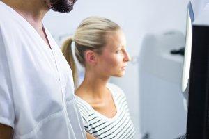 Woman receiving aesthetic laser scan