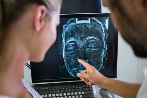 Woman looking mri scan report on computer screen