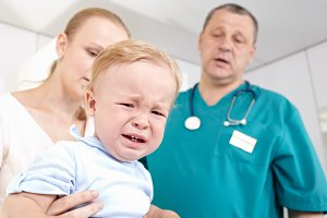 Boy frightened and crying medical
