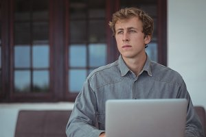 Man using laptop at desk