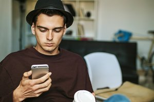 young man in casual style with the mobile phone