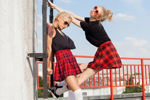 girls against urban white wall