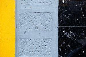 Yellow gray and black wall