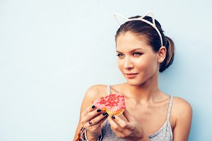 woman eating tasty donut