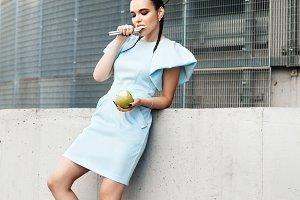 Pretty woman eating an apple