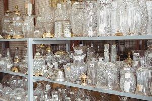 Empty glassware arranged on shelf in workshop