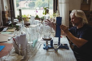 Glassblower working on a glassware