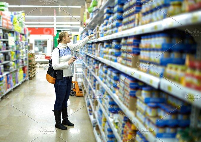 Woman in the supermarket. Kid's food - People