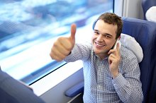 Young successful businessman train