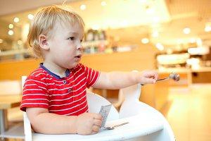 Little boy in the restaurant.