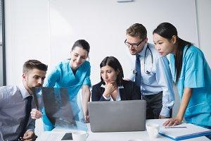 Medical team examining an x-ray report