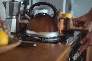 Preparing tea in teakettle on stove