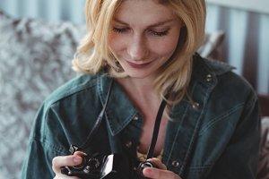 Beautiful woman looking at photographs