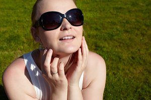 Young woman  sunglasses sunbathing