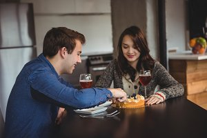 Couple celebrating together in living room