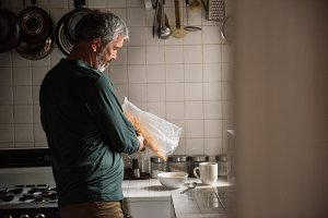 Man pouring cereals in bowl