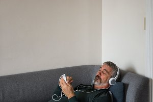 Man listening music on mobile phone