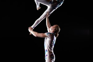 Circus artists perform different