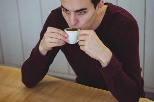 Man having coffee in coffee shop