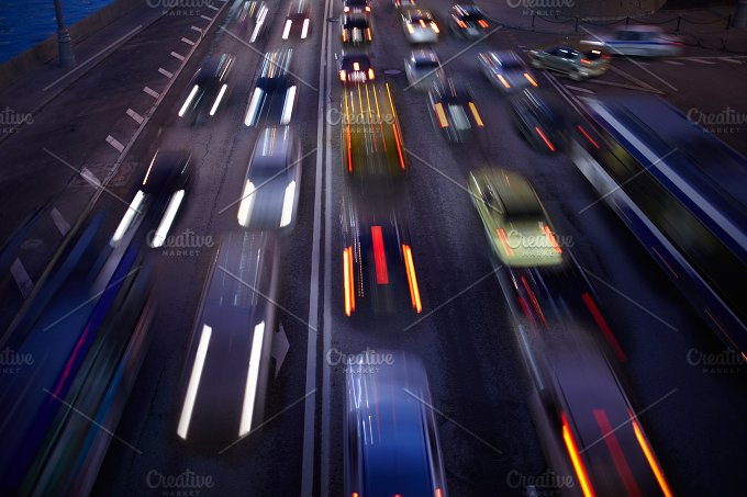 Car traffic at night. Motion blurred - People