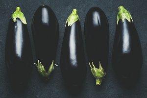 Eggplant on dark concrete background