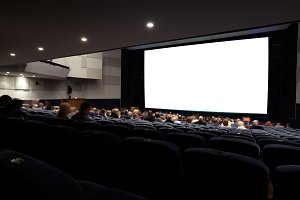 Cinema auditorium with people.